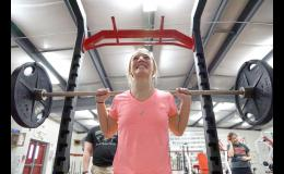 Senior Emma Saddoris practices the back squat lift at Greene County's weight room. Saddoris broke the national back squat record for 123 pounders by lifting 242 pounds at a NASA competition held in Des Moines.
