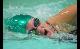 Freshman Haley Hall takes a breath while swimming freestyle at Boone's meet versus Roosevelt High School on Sept. 25. Hall swam freestyle on the third place medley relay team and on the first place 200 freestyle relay.