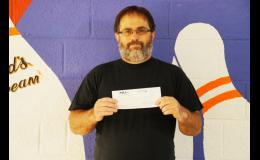 John Woodford is pictured holding his $400 check that he earned by placing in a Professional Bowlers Midwest Regional Tournament in Muscatine on Juley 26-27. He credits his new oiling machine that can put various oil patterns on the lanes as part of the reason that he bowled better in the tournament.