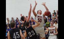 P-C's Noah Juergensen was met by a host of Nodaway Valley players whenever he got the ball in the paint. The Wolverines advanced to substate with their 66-48 win over the Rockets.
