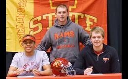 Daric Whipple (left) and Noah Juergensen (right) sit with Ram head football coach Dean Lansman inside the Greene County High School auditorium on Jan. 27. Whipple and Juergensen recently signed to play football for Iowa State University next year as preferred walk-ons. SPECIAL TO THE JEFFERSON HERALD