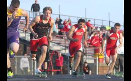 Max Neese (middle left) of Greene County explodes from the blocks during the boys 200 meter dash in Carroll on April 21. JEFF STORJOHANN | JEFFERSON HERALD