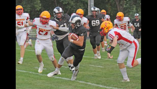 Greene County's Bryce Stalder (with ball) breaks loose while teammate Bradyn Smith (51) looks on during the Rams' 13-3 win over Kuemper Catholic Friday, Sept. 10 in Jefferson.  BRANDON HURLEY   JEFFERSON HERALD