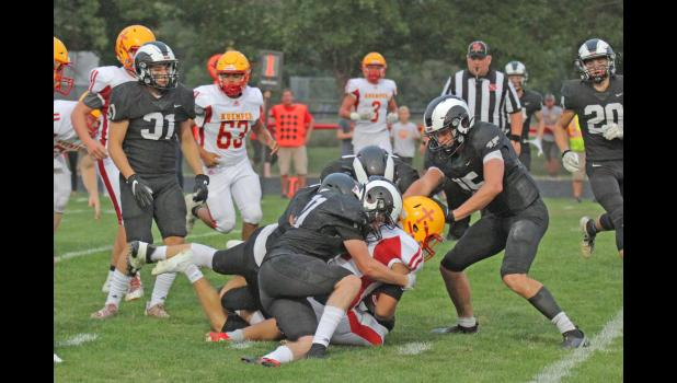 Greene County's Richard Daugherty (left) and Jackson Morton (right) helped bolster a strong defensive effort in the Rams' 13-3 win over Kuemper Catholic Sept. 10 in Jefferson, holding the Knights to 166 total yards.  BRANDON HURLEY   JEFFERSON HERALD