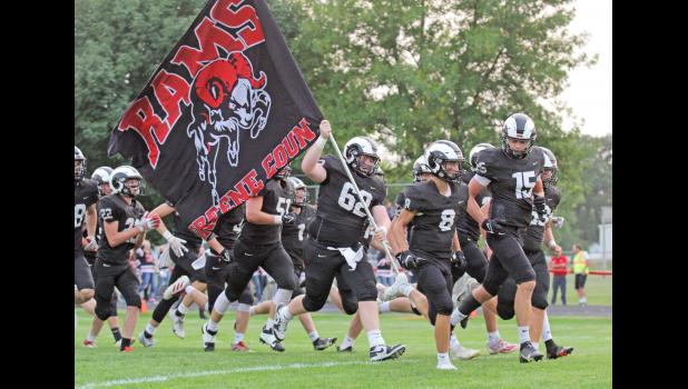 The Greene County Rams won their second straight game Sept. 10, defeating Kuemper Catholic, 13-3 in a tense battle at home. Mason Stream (62) is pictured carrying the team flag prior to kick-off.  BRANDON HURLEY   JEFFERSON HERALD