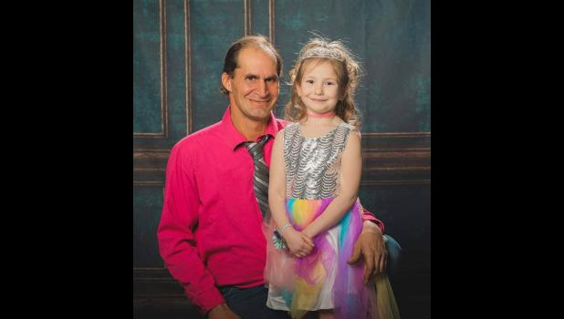 Travis Fincel, of Grand Junction, is pictured with his oldest granddaughter Makia at a recent daddy-daughter dance.
