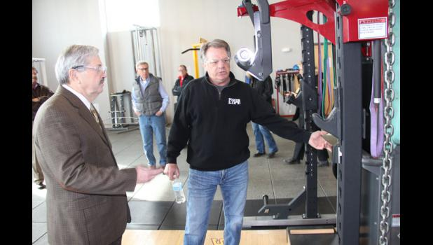 Jeff Conner (right), owner and CEO of Jefferson-based Power Lift, gives Gov. Terry Branstad a tour Wednesday of the company's 70,000-square-foot manufacturing facility on Highway 30. The strength-training equipment designed and built locally by Power Lift is in use by professional sports teams, universities and the U.S military. Current operations include 45 employees in Jefferson.