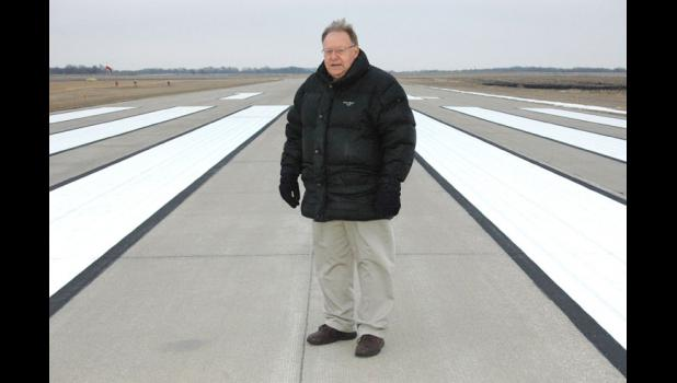"Jim Forbes, chairman of the Jefferson Airport Commission, is pictured in December 2013 on the runway of the Jefferson Municipal Airport that will be extended in the coming years. ""It's going to be good for the community,"" he said then, ""whether they believe it or not."""