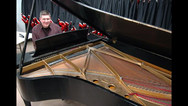 """If purchased new today, Greene County High School's Steinway Model B grand piano would cost more than $101,000. """"What a great thing to have,"""" says vocal music director David Heupel, pictured last week at the keys. Unfortunately, 45 years in a high school setting have taken their toll. The piano will be restored in time for the opening of the new high school and its 700-seat performing arts center. ANDREW McGINN   JEFFERSON HERALD PHOTOS"""