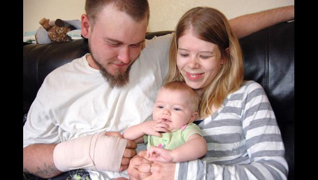 Chevie-Lynn Andrews (center), the infant daughter of Jeremy Andrews and Angie Bonnette, of Jefferson, will likely learn to walk on a prosthetic leg after her left leg is amputated. Chevie was born with a congenital fibular abnormality.