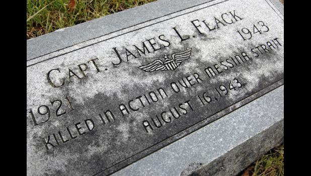 The grave marker of Capt. James L. Flack in the Jefferson Cemetery is just one of hundreds that inspire curiosity. A bomber pilot in World War II, he was shot down during the fight for Sicily. ANDREW McGINN | JEFFERSON HERALD