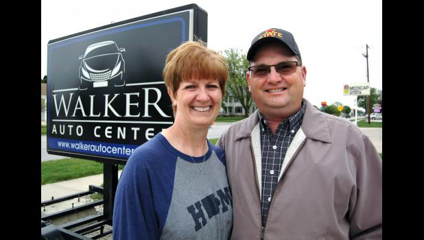 """""""We had a lot of people praying for him,"""" says Laurie Walker (left), pictured Monday with husband George Walker at their business in Jefferson. The Paton residents have had what they call a """"crazy spring."""" Now recovered, George Walker was Greene County's first confirmed case of COVID-19, a 12-day ordeal that took him to the edge of death. ANDREW McGINN 
