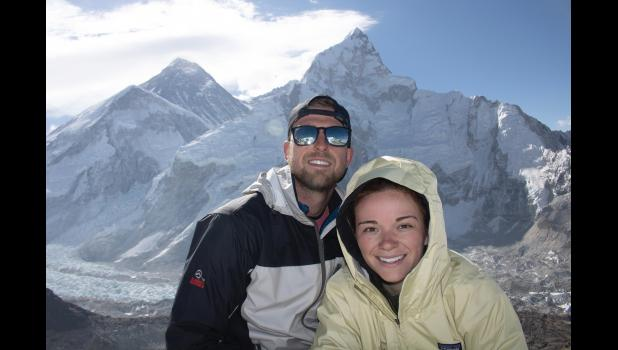 Chase Flack (left), a 2011 graduate of Jefferson-Scranton High School and the winningest wrestler in school history, stands in May at the summit of Kala Patthar in the Himalayas with girlfriend Hannah Woods. The mountain known as Lhotse is directly behind them. Mount Everest is off to the left. Flack died June 1 while running the DAM to DSM 20K in Des Moines, a shock to his hometown of Jefferson, where he was known for his athleticism.