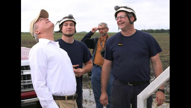 Former U.S. Sen. Jim Webb (left) admires the height of a Greene County wind farm. Webb stopped Monday at the Rippey Wind Farm near Grand Junction as part of a swing through Iowa.