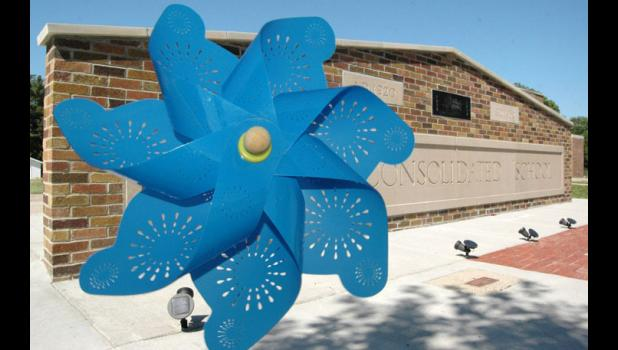 A pinwheel was left last week at the Rippey School Memorial in memory of Keith Devilbiss, the volunteer mason who recently completed the memorial. Devilbiss, 77, was killed June 15 when his ATV collided with a pickup truck in Rippey. ANDREW McGINN   JEFFERSON HERALD