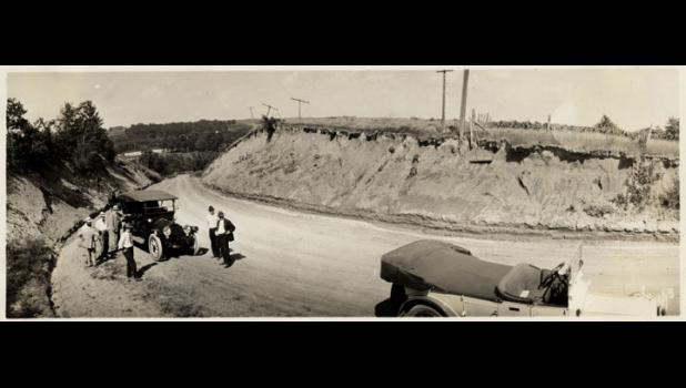 Greene County officials in 1918 grade the section of road that would be known to generations as Danger Hill two years after two sisters from New York rumbled across the Lincoln Highway on Indian motorcycles.