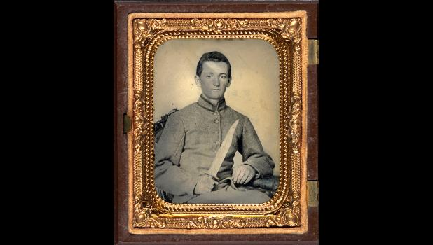 Traitor: A Confederate artilleryman poses with a large knife. After 155 years, we're still actively debating the cause of the Civil War, but history itself sets the record pretty straight.