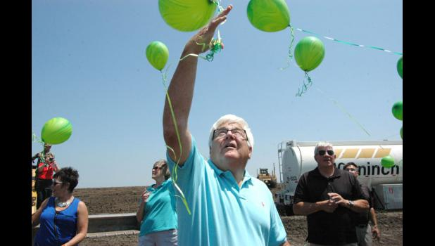 Greene County farmer and landowner Kim Rueter lets go of a balloon Thursday during the groundbreaking ceremony for the $40 million Wild Rose Jefferson casino on what had been his ground. It was Rueter who first pitched the idea of a casino in Greene County.