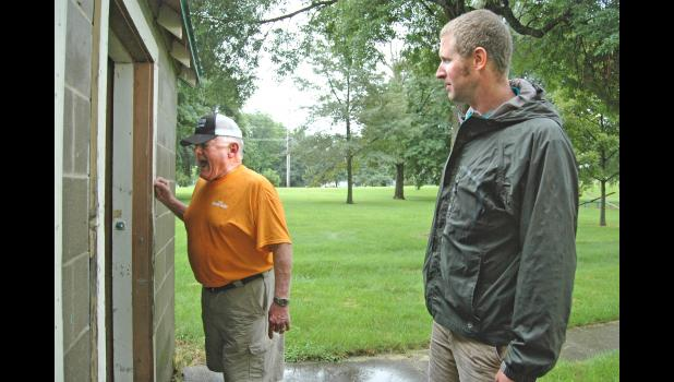 Retired police officer Les Fister (left) and the Rev. Devin Wolters, of the Greene County Homeless Coalition, check for signs of life July 31 in the restrooms at the city park in Scranton. The coalition was conducting its second Point-in-Time Count of the homeless this year, part of a growing trend in rural Iowa. The counties are finding that they all have people who have fallen through society's cracks. ANDREW McGINN   JEFFERSON HERALD