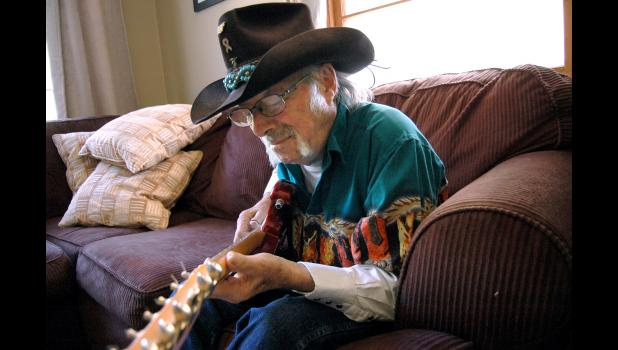 Local guitar great Don Muzney, pictured here shortly before he died, was the subject of an award-winning profile by Andrew McGinn in the Jefferson Herald. A Jefferson native himself, McGinn is leaving journalism after more than two decades.