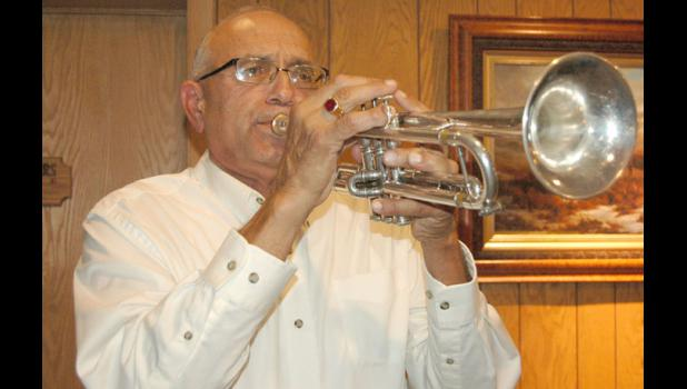 Wayne Lautner, of Jefferson, plays Taps last Thursday at the Jefferson Elks Lodge to close the annual Greene County Heroes Dinner on the anniversary of 9/11.