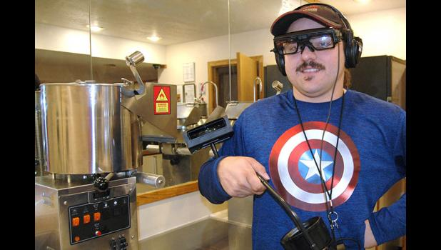 Sierra Community Theatre manager Dustin Gustoff models special headphones, closed-captioning glasses and a closed-captioning reader now available to make moviegoing a more enjoyable experience for all. ANDREW McGINN | JEFFERSON HERALD