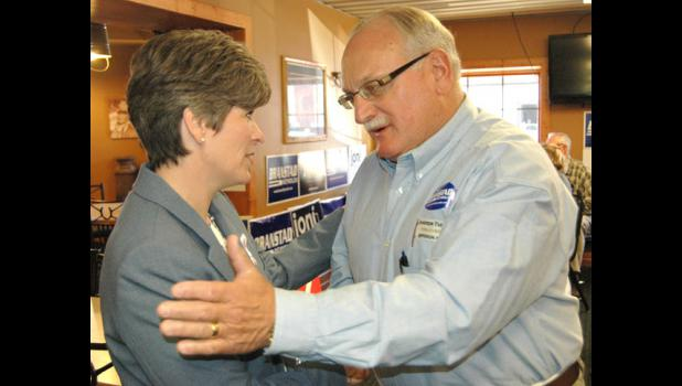 """I am so damn proud of you,"" Greene County farmer and Army veteran James O. Andrew (right) told Joni Ernst, Republican candidate for U.S. Senate and an Iraq War veteran, Monday at the Jefferson Pizza Ranch. Ernst greeted about 50 supporters."