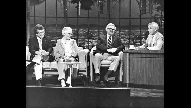 """The Cooper Three: Terry Rich (from left), Myrtle Whitcher and Gerald Lawton appear with Johnny Carson on """"The Tonight Show"""" in 1981, promoting the Cooper Centennial. In a publicity stunt dreamed up by Rich, the town set out to adopt a celebrity to be Cooper's honorary 51st resident. Johnny fit the bill. In his day job with Heritage Cablevision, Rich was promoted to corporate marketing for the stunt."""