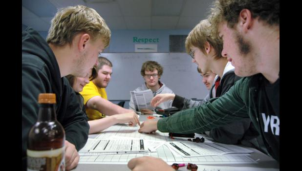 """Senior Gabe Jensen (center) leads a recent game of """"Dungeons & Dragons"""" after school at Greene County High School. The school board in March approved the creation of a fantasy role-playing club at the school. Participation has exceeded expectations. ANDREW McGINN 