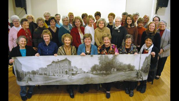 Holding up a photo taken 13 years before women earned the right to vote, the ornate building that dominates the picture (present-day Angie's Tea Garden) will soon be owned by a group of nearly 50 women investors. Calling themselves Why Not Us, more than two dozen of the founding members gathered Tuesday night at the Jefferson Community Golf Course to approve a mission plan and elect a board. ANDREW McGINN | JEFFERSON HERALD PHOTOS