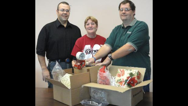 Jim Groves, Corrugated Manager; Betty Niles, Corrugated Marketing Rep; and Tim Hegstrom.