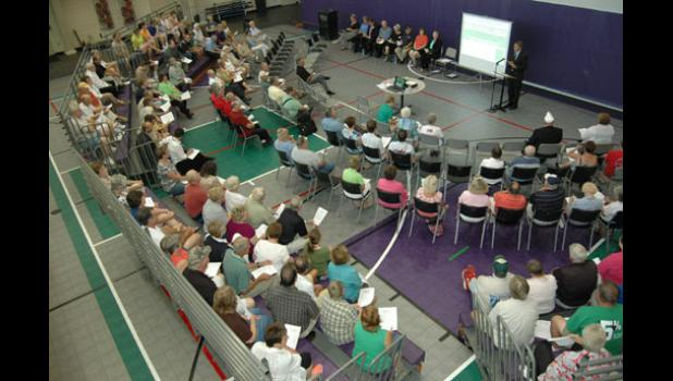 In this 2014 file photo, a crowd gathers at the Greene County Community Center to hear about ongoing building projects from Ken Paxton, executive director of the Greene County Development Corp.