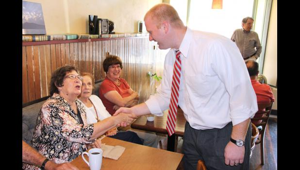 Jim Mowrer speaks with Karen Voge-Perkins in Jefferson during a campaign stop Friday.