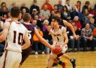 Jake Carey dribbles through a crowd in the Rockets 48-32 win over Exira/EHK on December 10. Jake scored 12 points in the game against the Spartans, but scored 31 in Paton-Churdan's win over Charter Oak-Ute on December 6. Carey is the Rocket's point guard and is their main ball handler.